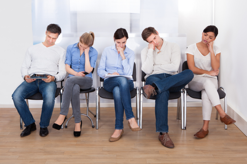 Young Group Of People Sleeping On Chair In A Waiting Room